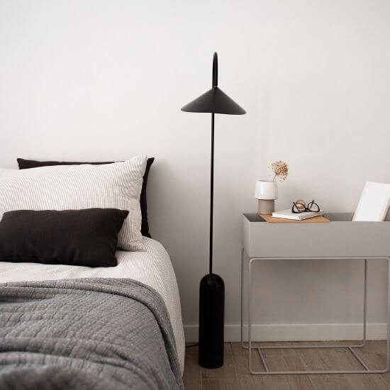 minimalist bedroom featuring black and white accents - productivity tip for moms #1 - get enough rest