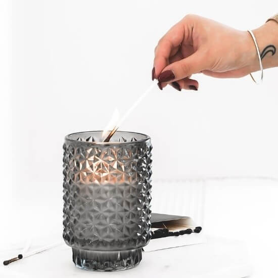halloween blog post ideas -woman lighting candle