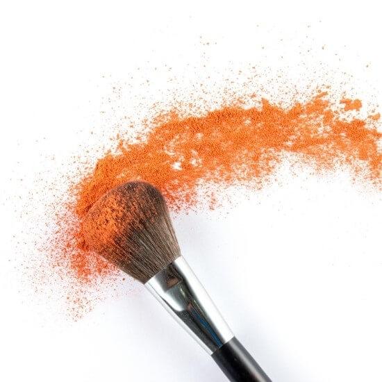 halloween blog post ideas - brush running through orange makeup