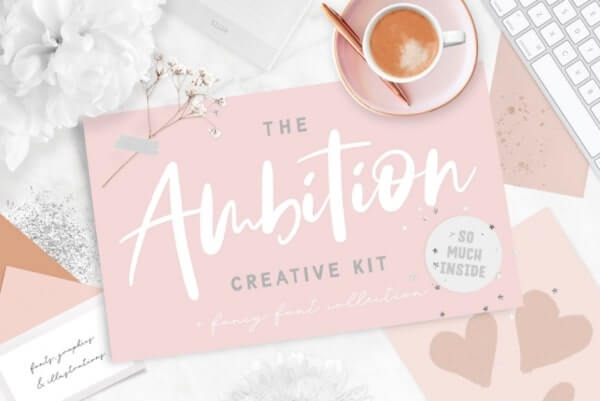 text reads the ambition creative kit against a pink and white background setting with coffee cup