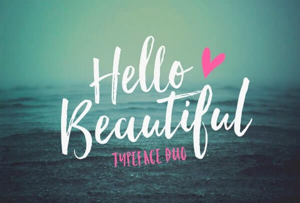 text reads hello beautiful in white against blue ocean setting