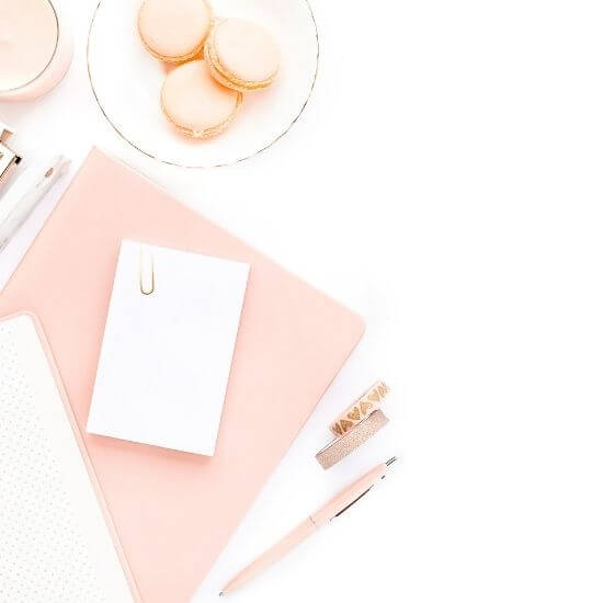 valentine's day blog post ideas - pink notebook, macarons, and pen