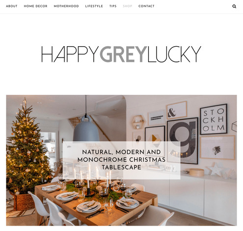 screenshot of happy grey luck lifestyle blog home page