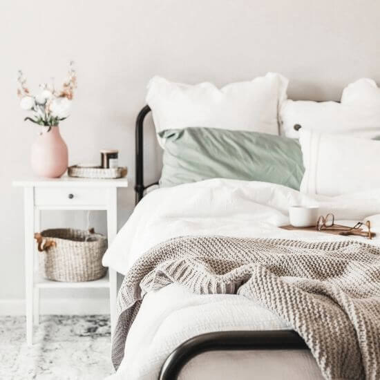 tidy bedroom featuring earthy colors - productive things to do at home - clean up!