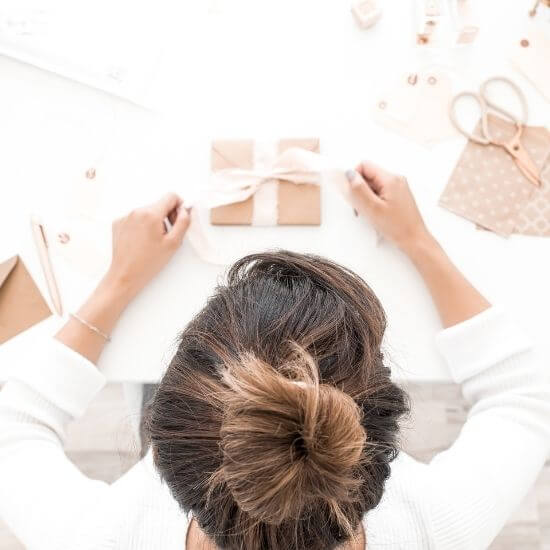 top down photo of woman making crafts to sell online