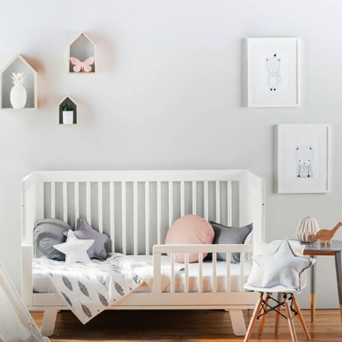 photo of a stunning kids room featuring minilogie baby blanket and pillows