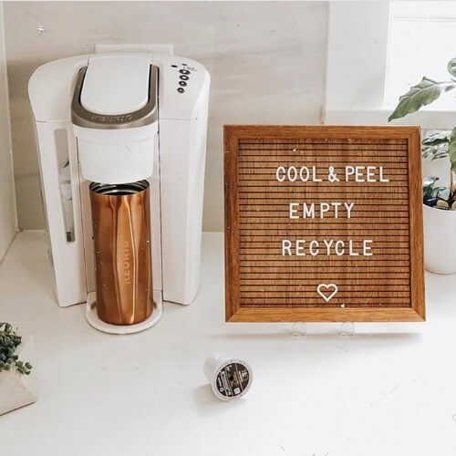 wooden letterboard made by parkside home next to a keurig coffee maker