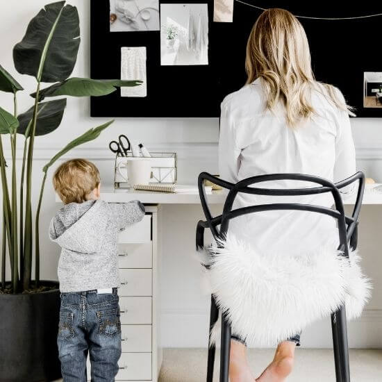 stay at home mom jobs with no experience required - mom working in home office with child