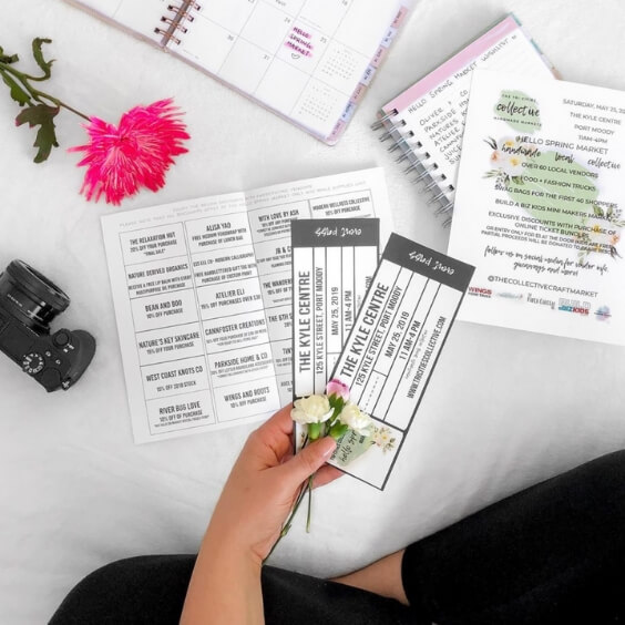flat lay photo featuring hands and holding event tickets