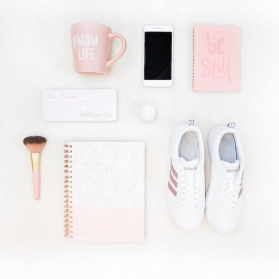 feminine flat lay photo of girl items including runners, mug, agenda, and iphone
