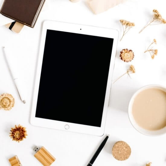 how to start a blog on instagram - clean up ideas - top down of ipad, stationary, and coffee