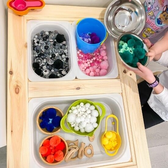 top down photo of ikea flisat table being used as a sensory table