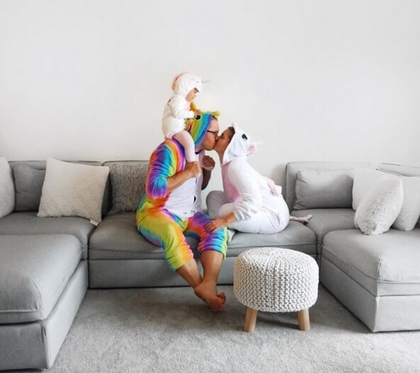 nikki, husband, and daughter dressed in unicorn family halloween costume