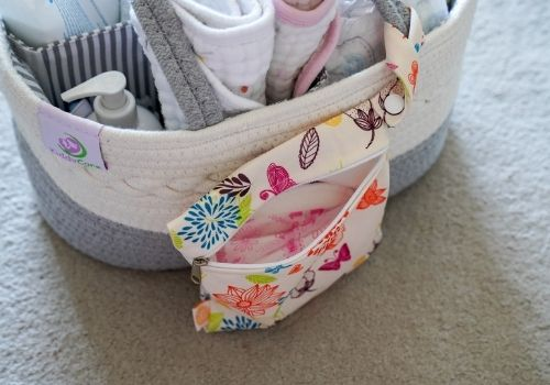 woven diaper basket with nursing pad bag attached