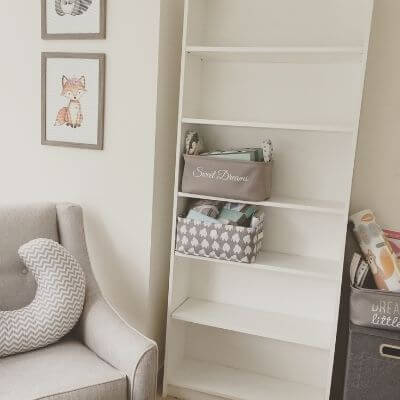 baby glider set up with other nursery furniture