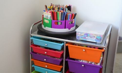 kids art supplies organization station with colorful turntable