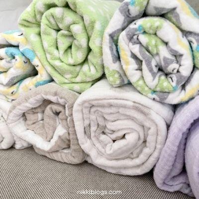 swaddles folded under receiving blankets