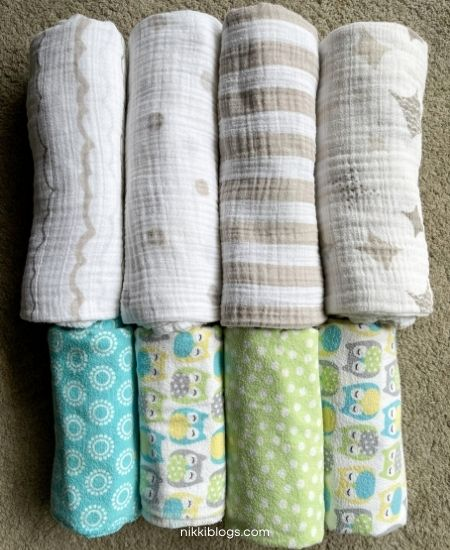 swaddles vs receiving blankets folded next to each other